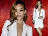 Rihanna slips into plunging white jacket and tiny shorts after tearing up the stage at star-studded Los Angeles gig