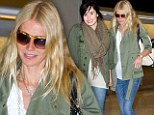 You two must've planned this! Worlds collide as Gwyneth Paltrow and Demi Lovato meet on flight wearing identical casual outfits
