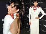 Baby got back! Paula Patton attends the New York screening of her film Disconnect in a skin-baring white dress
