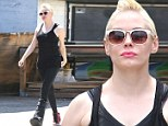 Booted: Rose McGowan headed to the gym wearing a large cast on her left foot in West Hollywood, on Monday