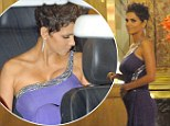 Pregnant and proud! Halle Berry cradles her prominent baby bump as she hits the red carpet glowing in a stunning purple gown
