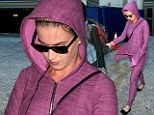 So much purple! Katy Perry heads out of Los Angeles International Airport in full violent ensemble on Tuesday