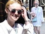 Dakota Fanning is downright angelic as she walks the streets in all-white ensemble