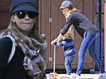 Elizabeth Banks and son Felix play with scooter in the New York sunshine
