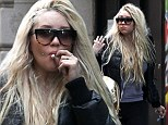 Amanda Bynes smokes a joint in Times Square after reports she was 'escorted out of gym by staff' due to bizarre behavior