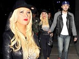 A very tight squeeze! Christina Aguilera shows off her bumper curves in black jeans during Rihanna show outing with boyfriend