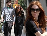 The red hair gives her away! Julianne Moore fails to stay low key in a casual outfit as she takes a stroll with husband Bart