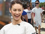 A delight in white! Olga Kurylenko is pretty as a picture in a lacy dress which shows off her slender figure