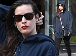 Liv Tyler goes undercover in shades and a dark hoodie but her red lips stand out a mile