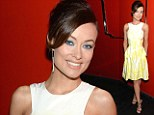 Pretty in pastels! Olivia Wilde floats into spring in a yellow and white dress which shows off her ultra slim figure
