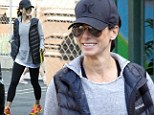 Ready for anything! Sandra Bullock drops off son Louis at school in a busy-day outfit that highlights her fit frame