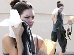 Fresh faced Kendall Jenner lets her natural beauty shine through she she heads to the gym in casual workout gear