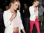 RiRi would approve! Rosie Huntington-Whiteley wears tight leather jeans and midriff baring top for Rihanna concert