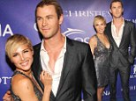 Showing off their assets: Chris Hemsworth and his wife Elsa Pataky both wear plunging necklines on the red carpet