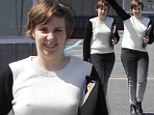 From frumpy to fashion plate! Lena Dunham gets stylish as she dons monochrome ensemble to shoot new season of Girls
