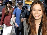 Hardly drab to fab: Elizabeth Olsen refuses to budge out of her casual duds as she hits the red carpet after outing with boyfriend Boyd Holbrook