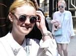 Dakota Fanning is downright angelic as she walks the streets in all-white ensemble