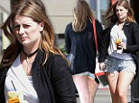 Keeping things a little TOO brief: Yo-yo dieter Mischa Barton shows off her curves in a pair of painstakingly small ripped Daisy Dukes