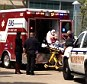 A victim is loaded into an ambulance after an attack left several people injured on the Lone Star College Cy-Fair campus