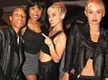 Miley Cyrus bares her midriff in bra-top and basketball shorts for Pharrell Williams birthday bash