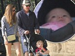 Hello sunshine! Guy Ritchie's baby daughter makes her public debut during family day at the park