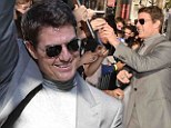 Tom Cruise arrives at film premiere early to mingle with fans... and channels retro fashion in turtleneck and grey suit