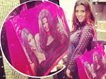 Can't bear to apart! Kourtney Kardashian shows off new bag embossed with image of her sisters
