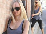 She wears them well! Make-up free Kimberly Stewart displays her super slim legs in a clingy leggings as she heads to her daily workout