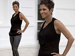 Sheer baby bliss! Beaming Halle Berry displays her blossoming pregnancy figure in a black transparent top and skin tight leather trousers