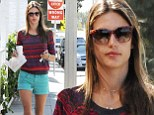 Legs for days! Model Alessandra Ambrosio braves Los Angeles heat wave in teal micro-shorts and over-sized shades