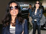 Every woman's envy! Salma Hayek reveals flawless complexion and luscious curls after 15-hour flight delay