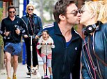 Still going strong! Hugh Jackman and wife Deborra-Lee share a kiss one day before 17th wedding anniversary