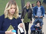 Family day out: Peaches Geldof, Thomas Cohen and baby Astala walk in the park
