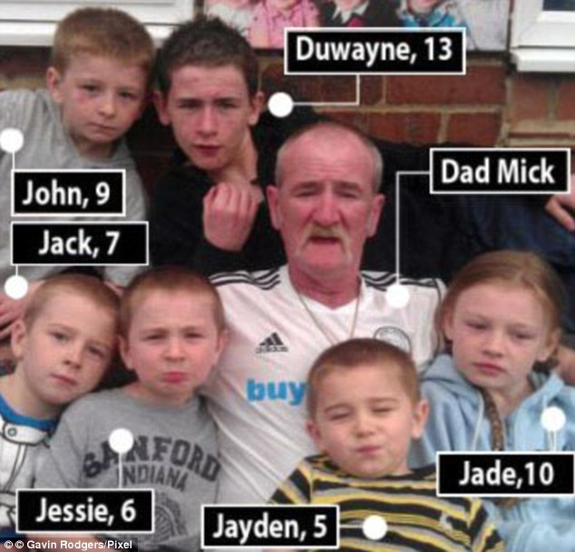 Drug-taking layabout: Philpott with six of the children he killed after starting the fire at his home