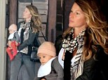 Gisele Bundchen leaves an office building in New York City with her daughter, Vivian Lake, on Thursday