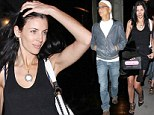 Giddy as a teenager! Liberty Ross can't wipe the smile off her face as rumoured beau Jimmy Iovine lavishes her with gifts over dinner
