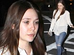 Low-maintenance beauty Elizabeth Olsen shows off makeup-free face as she steps out in sheer tunic