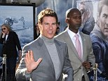 'I am just focusing on work': Tom Cruise dodges questions about his love life as he thrills fans on Oblivion red carpet