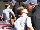 Jennifer Garner and Ben Affleck steal a kiss outside of their daughter's school in Los Angeles on Wednesday