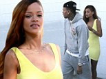 Rihanna wears figure-hugging yellow dress to go on shopping date with Chris Brown... but couple appear tense amidst claims of renewed fighting