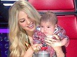Shakira's 11 week-old son Milan attempts to press the chairs button