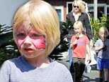 Pretty butterfly! Naomi Watts's son Sasha showed off his pink face paint as the two visited Brentwood Country Mart on Thursday in California, alongside her other son Samuel (not pictured)