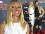 Yes, he's with me... unfortunately! White hot Gwyneth Paltrow poses with lederhosen-clad Robert Downey Jr. at Iron Man 3 Munich photocall