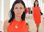 Liberty Ross wears orange to a fashion event at Barneys New York in Beverly Hills