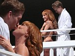 Kiss me quick! Kathy Griffin, 52, shares a passionate lip lock with toyboy lover Randy Bick, 33, as he playfully adjusts her bra