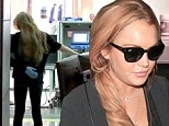 Lindsay Lohan received a pat-down from a TSA agent at JFK airport in Queens, New York on Wednesday