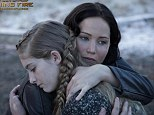A fiery embrace! Katniss hugs sister Prim in exciting new The Hunger Games: Catching Fire image