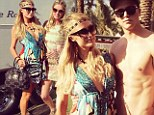 Desert chic! Sexy sisters Paris and Nicky Hilton show off their long legs in printed mini dresses as they hang out backstage at Coachella 2013