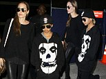 Angelina Jolie and son Maddox wore bold black outfits as they arrived Friday at Los Angeles International Airport following her appearance at the G8 Summit in London
