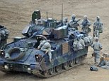 Final preparations: U.S. soldiers check their tank at a military training field near Seoul, South Kore,a as the Obama administration warned North Korea it is skating a 'dangerous line' with its proposed missile launch